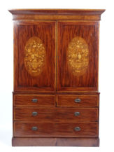 Pine and oak construction, veneered with mahogany and walnut, inlay in various types of wood, brass keys and pulls, mid-19th c
