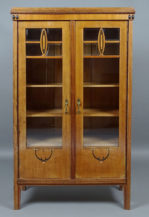 Construction of oak and mahogany, veneered with oak, blackened elements, mother of pearl, carvings, brass handles, c. 1920.