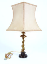 Gilded bronze, ceramic base, converted from a candlestick, electrically working, early 20th century.